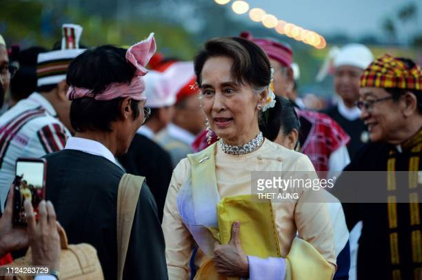 Myanmar State Counsellor Aung San Suu Kyi arrive to attend a reception to mark the 72nd anniversary of country's National Union Day in Naypyidaw on...