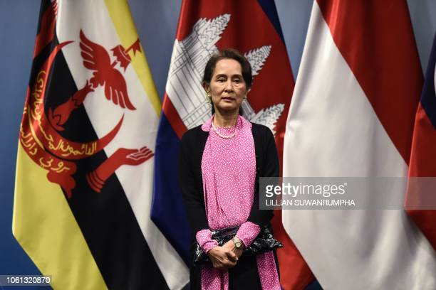 Myanmar State Counsellor Aung San Suu Kyi arrives on stage to pose for a group photo before the start of the ASEAN-Japan summit on the sidelines of...