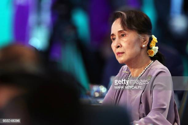 TOPSHOT Myanmar State Counsellor Aung San Suu Kyi attends the Leaders Plenary Session of the Association of Southeast Asian Nations Australia Special...