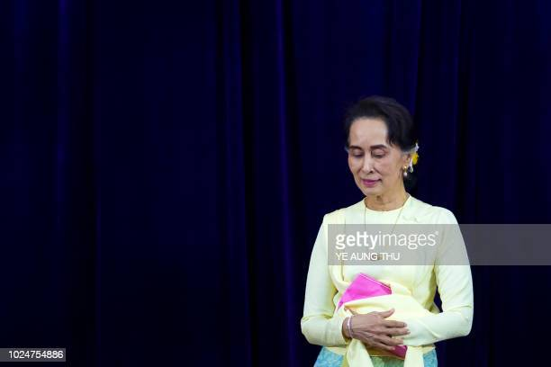 TOPSHOT Myanmar State Counsellor Aung San Suu Kyi leaves after delivering address before students of Yangon University general assembly in Yangon on...