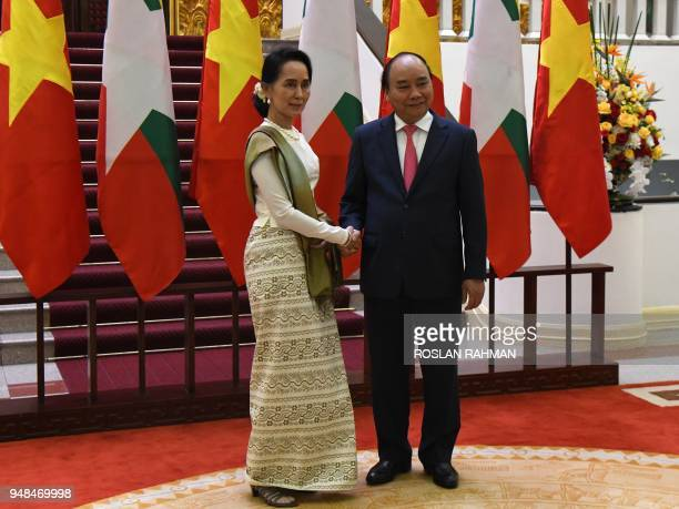 Myanmar state counsellor Aung San Suu Kyi shakes hands with Vietnamese Prime Minister Nguyen Xuan Phuc at the presidential palace in Hanoi on April...