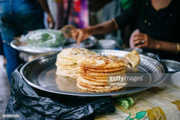 myanmar street food pancake, bein mote, yangon - yangon stock pictures, royalty-free photos & images
