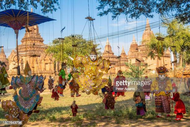 myanmar string puppets on sale outside a temple in bagan, myanmar - peter adams stock pictures, royalty-free photos & images