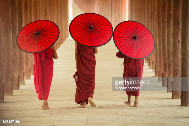 myanmar three novice monks together - unesco stock pictures, royalty-free photos & images