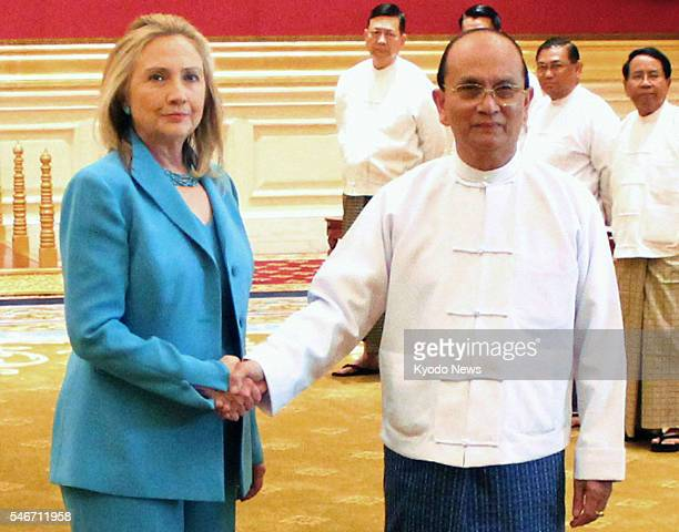 Myanmar - U.S. Secretary of State Hillary Clinton shakes hands with Myanmar President Thein Sein at the presidential office in Myanmar's...