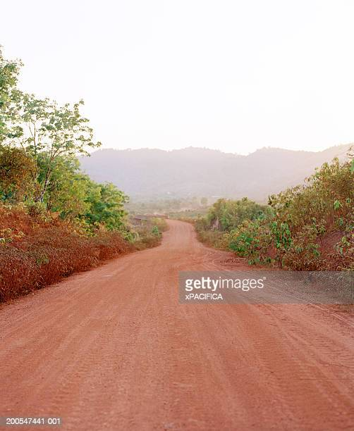 Myanmar, Yadana Pipeline, dirt road leading to mountains