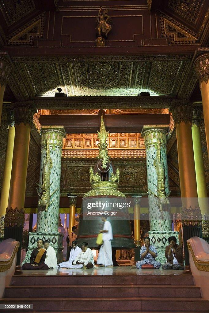 Myanmar, Yangon, Shwedagon Paya, worshippers at pavillion : Stock Photo