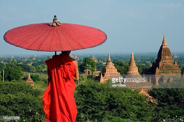 myanmar: young monk overlooks bagan temples - myanmar stock pictures, royalty-free photos & images