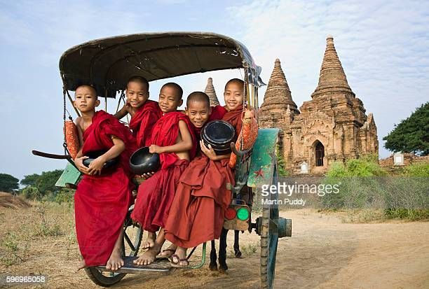 Myanmar,Bagan,Buddhist monks sitting in horse pulled cart