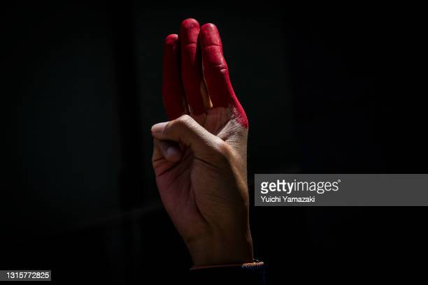 Myanmarese resident in Japan holds up the three finger salute during a protest on May 02, 2021 in Tokyo, Japan. Myanmar has now entered its fourth...