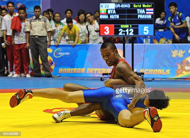 Myanmarese wrestler Wnna Hutn fights Thailand's Pravan during a wrestling match at the 27th Southeast Asian Games in Yangon on December 9 2013 AFP...