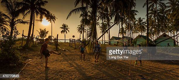 Myanmar,Ngwe Saung. January 16 - a group of children playing Takraw ball.
