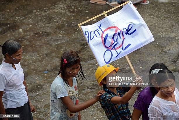 WITH 'MyanmarpoliticsreligionunrestFOCUS' by Amelie BottollierDepois This picture taken on October 10 2012 shows ethnic Rakhine Buddhist women...