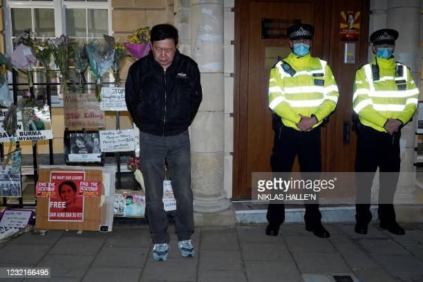 Myanmar's Ambassador to the United Kingdom, Kyaw Zwar Minn, stands locked outside the Myanmar Embassy in London on April 7, 2021. - Myanmar's...