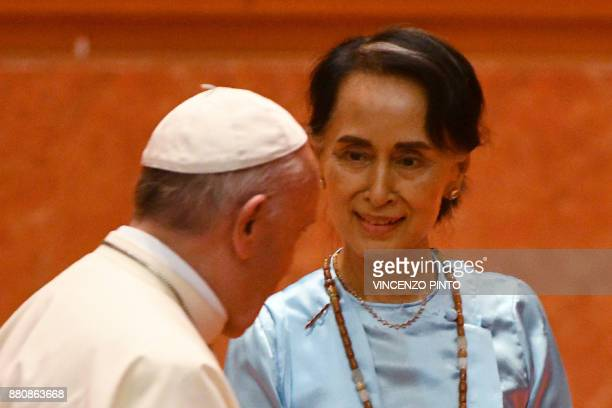 Myanmar's civilian leader Aung San Suu Kyi looks at Pope Francis during an event in Naypyidaw on November 28 2017 Pope Francis held talks with...
