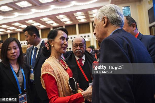 Myanmar's civilian leader Aung San Suu Kyi speaks with visiting leaders at the opening ceremony of the 'CPC in dialogue with world political parties...