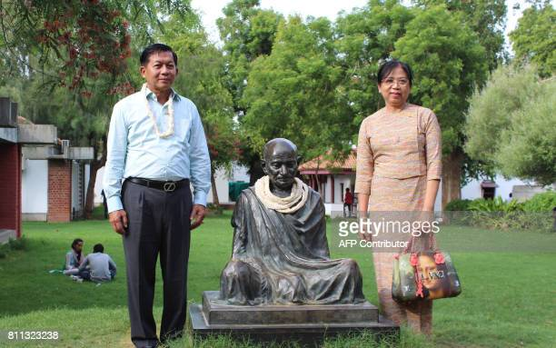 Myanmar's Defence Commander in Chief Senior General Min Aung Hlaing and his wife Daw Kyu Kyu Hla pose for a photograph at the Gandhi Ashram alongside...