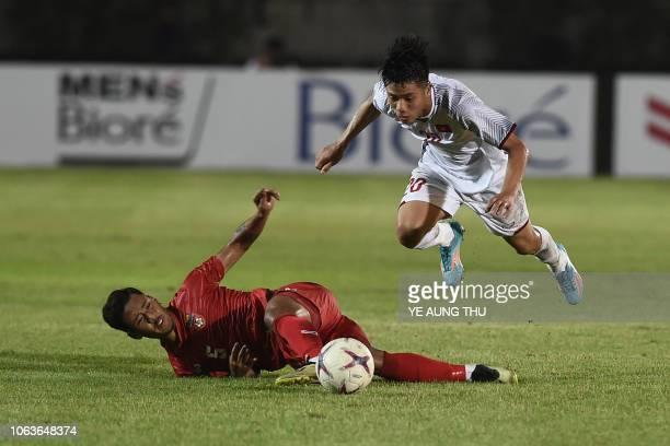 Myanmar's defender Nanda Kyaw fights for the ball with Vietnam's forward Phan Van Duc during the AFF Suzuki Cup 2018 football match between Myanmar...