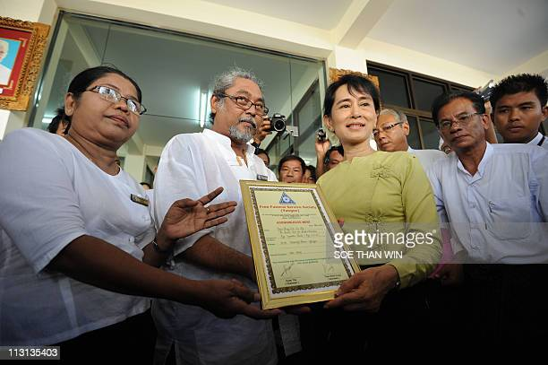Myanmar's democracy icon Aung San Suu Kyi accepts an acknowledgement letter upon her donation during the opening ceremony of the 10th founding...