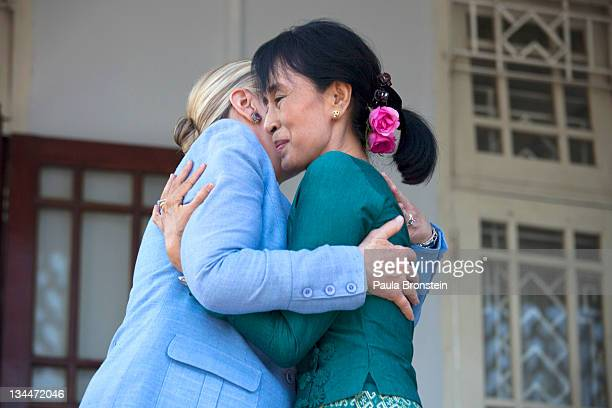 Myanmar's democracy leader Aung San Suu Kyi and US Secretary of State Hillary Clinton embrace after their meeting at Suu Kyi's residence laying out a...
