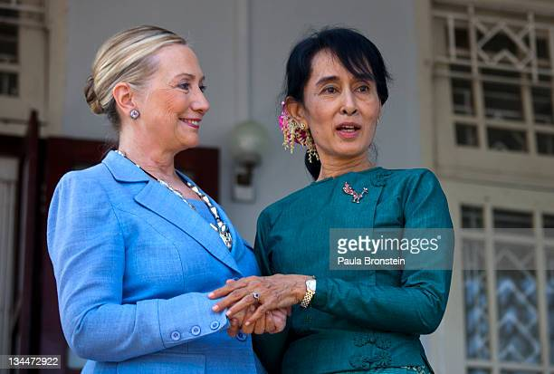 Myanmar's democracy leader Aung San Suu Kyi and US Secretary of State Hillary Clinton speak together after their meeting at Suu Kyi's residence...