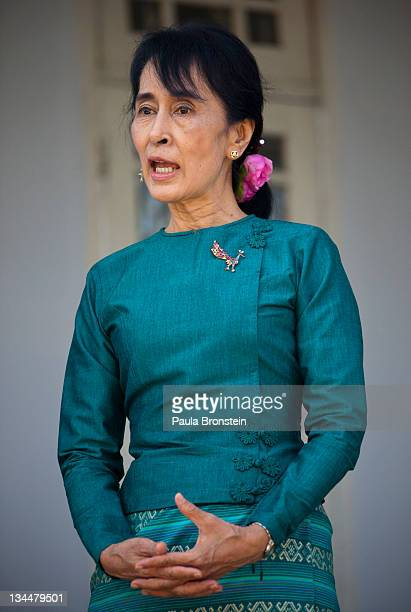 Myanmar's democracy leader Aung San Suu Kyi speaks during a press conference along side US Secretary of State Hillary Clinton outside Suu Kyi's...