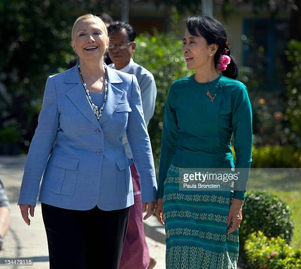 Myanmar's democracy leader Aung San Suu Kyi walks along side US Secretary of State Hillary Clinton in the garden outside Suu Kyi's residence after...