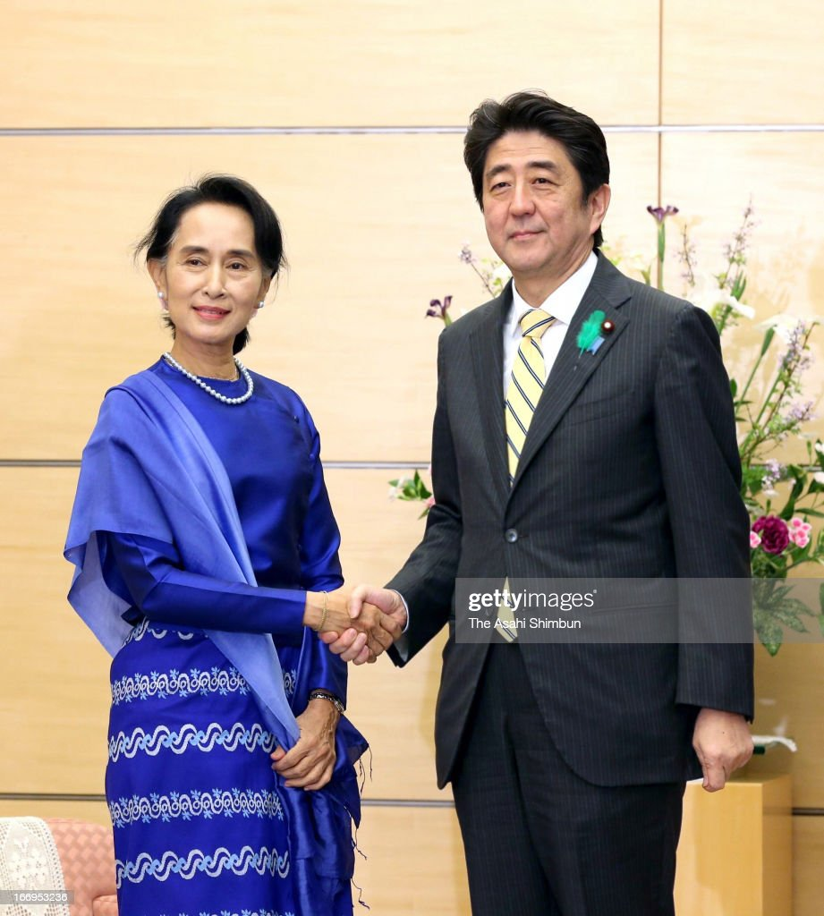 Aung san suu kyi visits japan day 6 photos and images getty images myanmars democratic leader aung san suu kyi l and japanese prime minister shinzo abe m4hsunfo