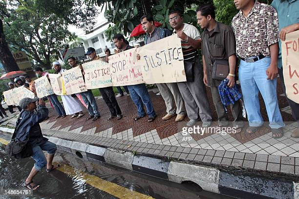Myanmar's ethnic Rohingya Muslims display placards near the British embassy in Kuala Lumpur on July 19 2012 Rohingya refugees protested outside the...
