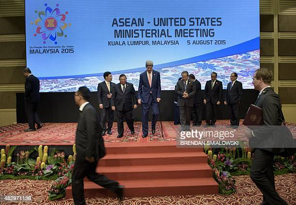 Myanmars Foreign Minister Wunna Maung Lwin and US Secretary of State John Kerry leave after a group photo before a USASEAN Ministerial Meeting at the...