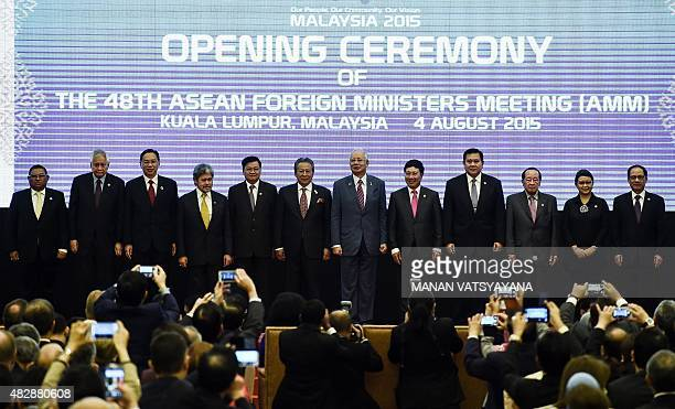 Myanmar's Foreign Minister Wunna Maung Lwin Philippine Foreign Secretary Albert del Rosario Singapores Foreign Affairs Permanent Secretary Chee We...