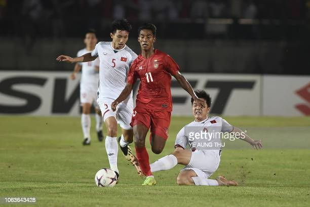 Myanmar's forward Maung Maung Lwin fights for the ball with Vietnam's midfielders Doan Van Hau and Luong Xuan Truong during the AFF Suzuki Cup 2018...