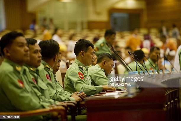 Myanmar's military members of parliament attend the new lower house parliamentary session in Naypyidaw on February 1 2016 Aung San Suu Kyi led her...