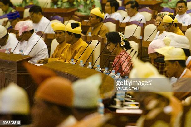 Myanmar's National League for Democracy chairperson Aung San Suu Kyi attends the new lower house parliamentary session in Naypyidaw on February 1...