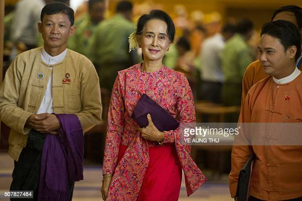 Myanmar's National League for Democracy chairperson Aung San Suu Kyi leaves after the new lower house parliamentary session in Naypyidaw on February...