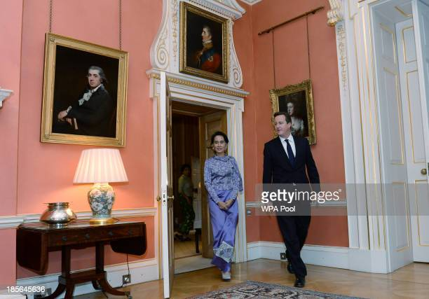 Myanmar's opposition leader Aung San Suu Kyi meets with Britain's Prime Minister David Cameron at 10 Downing Street on October 23 2013 in London...