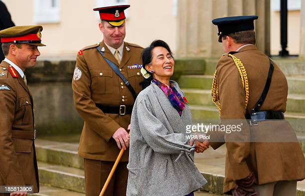 Myanmar's opposition leader Aung San Suu Kyi wearing a remembrance poppy is met by Academy Adjutant Major Chris Sargent and Academy Commandant Major...