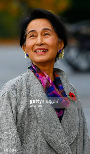 Myanmar's opposition leader Aung San Suu Kyi wearing a remembrance poppy arrives at the Royal Military Academy Sandhurst on October 25 2013 in...