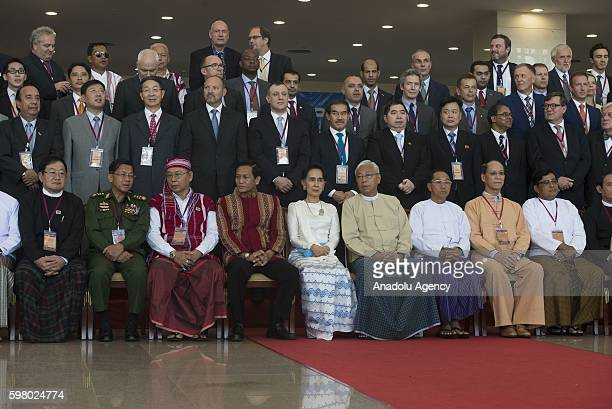 Myanmar's President Htin Kyaw Myanmar's Foreign Minister and State Counselor Aung San Suu Kyi and other participants pose for a group photo after the...