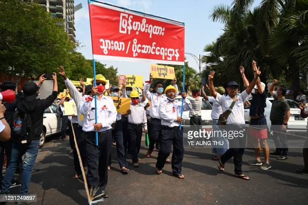 Myanmar's railway staff members take part in a protest demanding the release of detained Myanmar leader Aung San Suu Kyi during a demonstration...