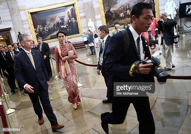 Myanmar's State Counsellor Aung San Suu Kyi 1991 recipient of the Nobel Peace Prize is escorted through the US Capitol rotunda by Frank Larkin US...
