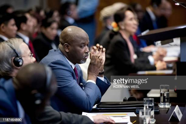 Myanmar's State Counsellor Aung San Suu Kyi and Gambian Justice Minister Abubacarr Tambadou sit before UN's International Court of Justice on...