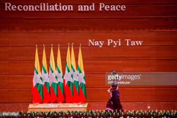 TOPSHOT Myanmar's State Counsellor Aung San Suu Kyi arrives to deliver a national address in Naypyidaw on September 19 2017 Myanmar leader Aung San...