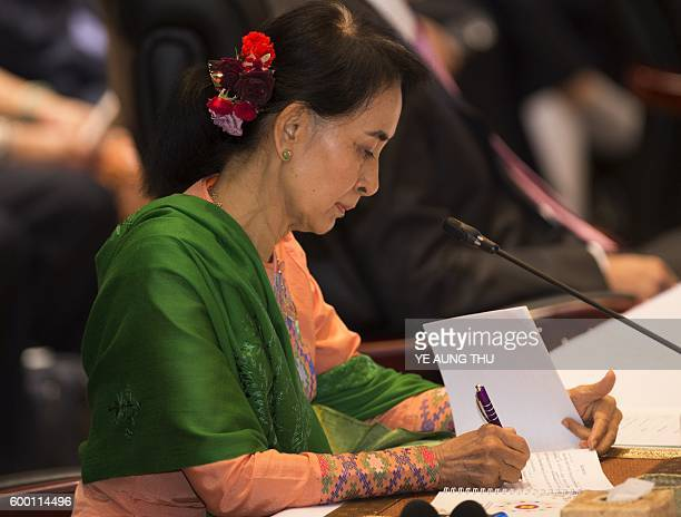 Myanmar's State Counsellor Aung San Suu Kyi listens during a speech by US President Barack Obama at the ASEANUS Summit in Vientiane on September 8...