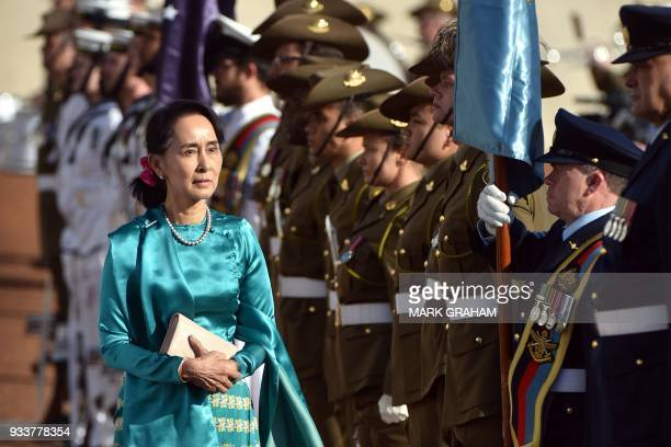 TOPSHOT Myanmar's State Counsellor Aung San Suu Kyi receives an official welcome on the forecourt during her visit to Parliament House in Canberra on...