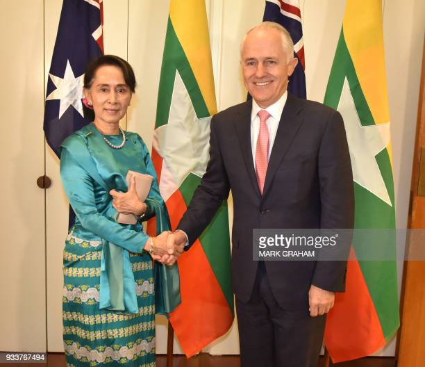 Myanmar's State Counsellor Aung San Suu Kyi shakes hands with Australian Prime Minister Malcolm Turnbull in Parliament House Canberra on March 19...