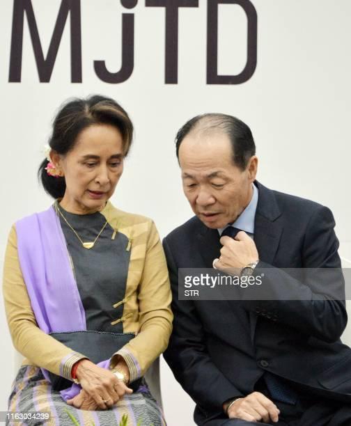 Myanmar's State Counsellor Aung San Suu Kyi speaks with Japan's Ambassador to Myanmar Ichiro Maruyama during a Myanmar Japan Thilawa Development...