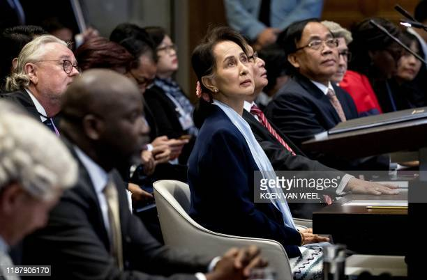 TOPSHOT Myanmar's State Counsellor Aung San Suu Kyi stands before the UN's International Court of Justice on December 11 2019 next to Abubacarr...