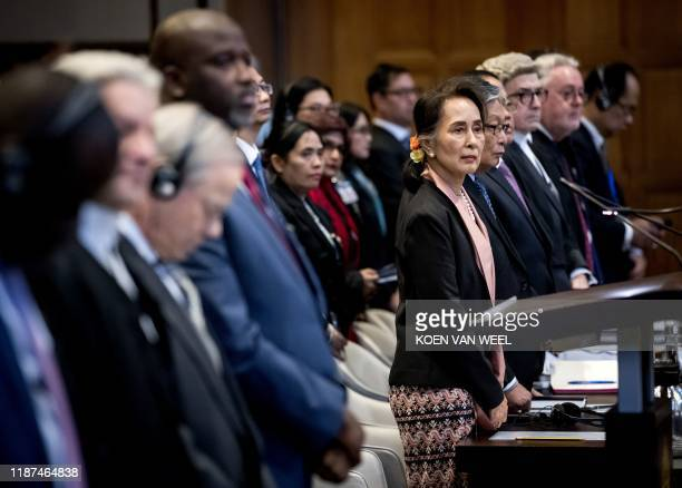 Myanmar's State Counsellor Aung San Suu Kyi stands before UN's International Court of Justice on December 10 2019 in in the Peace Palace of The Hague...