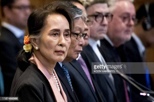 TOPSHOT Myanmar's State Counsellor Aung San Suu Kyi stands before UN's International Court of Justice on December 10 2019 in in the Peace Palace of...